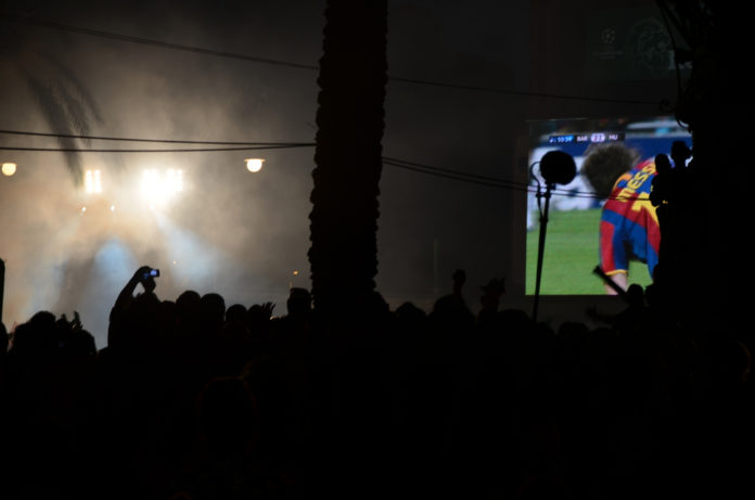 Lionel Messi celebrates his goal on the big screen / Ben Sutherland